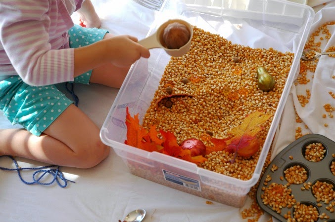playing with fall sensory bin