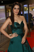 Raashi Khanna in Dark Green Sleeveless Strapless Deep neck Gown at 64th Jio Filmfare Awards South ~  Exclusive 070.JPG
