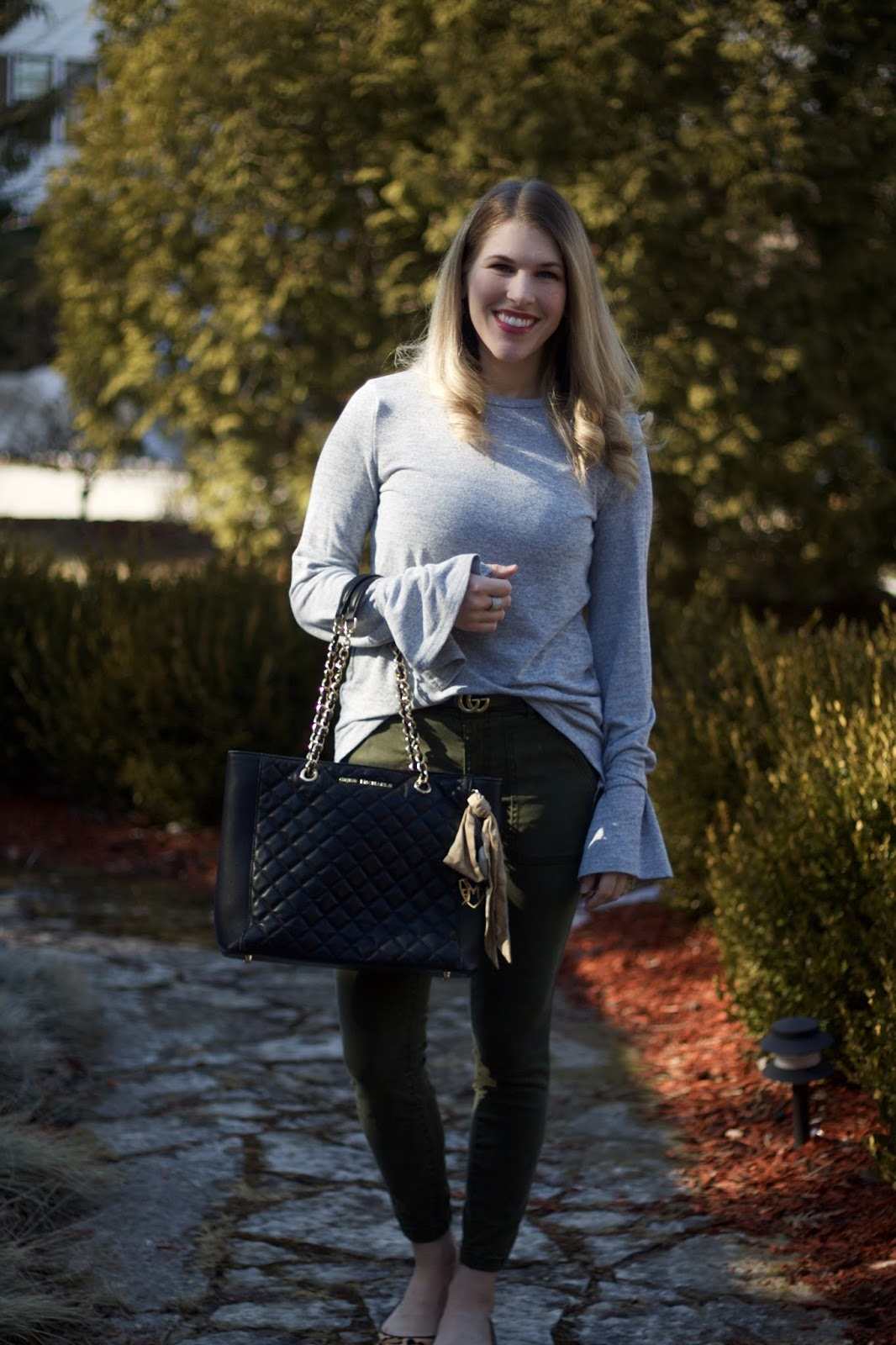 grey tie sleeve sweater, LOFT olive pants, leopard flats, Greg Michaels black quilted tote, black tassel earrings