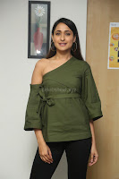 Pragya Jaiswal in a single Sleeves Off Shoulder Green Top Black Leggings promoting JJN Movie at Radio City 10.08.2017 055.JPG