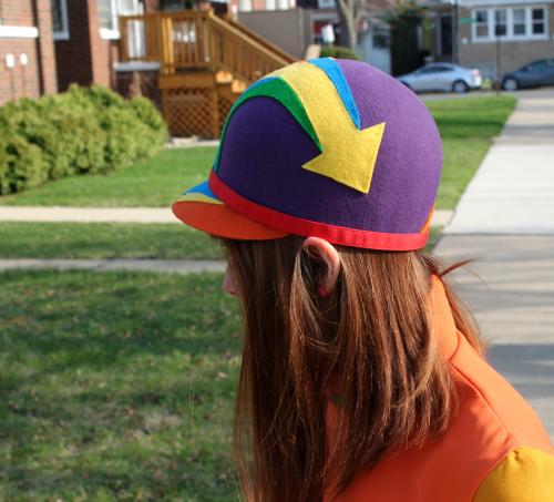 1960s style millinery helmet hat with arrow