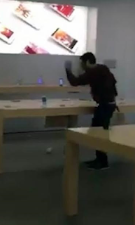 Man smashes iPhone