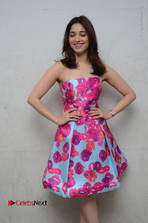 Actress Tamanna Latest Images in Floral Short Dress at Okkadochadu Movie Promotions  0064.JPG