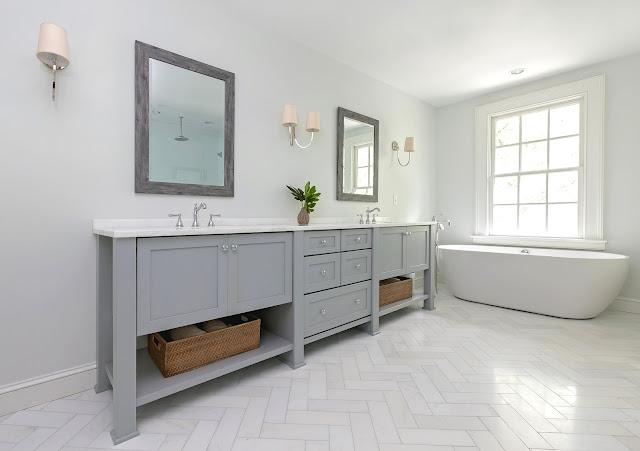 bathroom vanity shelf baskets polished chrome hardware white marble floors marble countertop