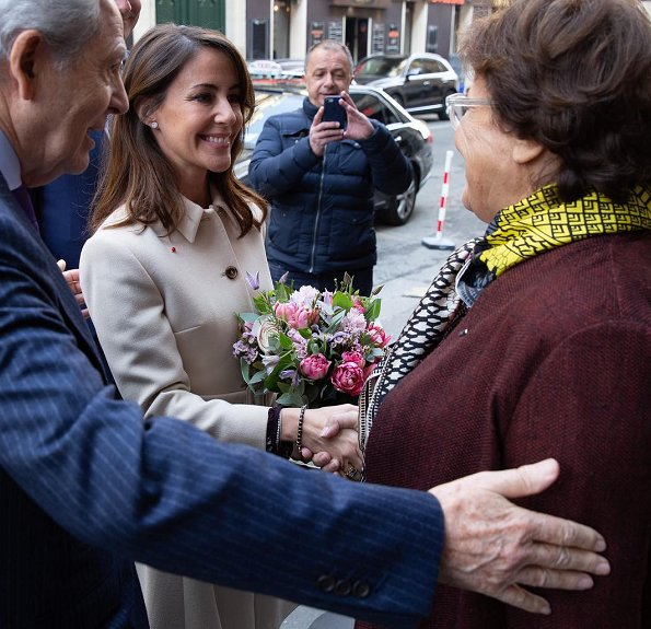 Princess Marie wore Velvet by Graham & Spencer Pomona floral printed challis wrap dress and Miu Miu belted wool crepe coat