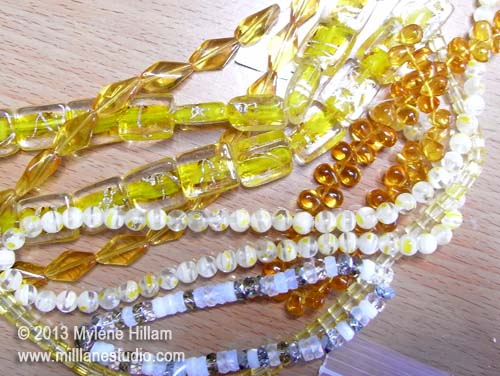 Translucent bead strands in limey yellow, mustard and amber.