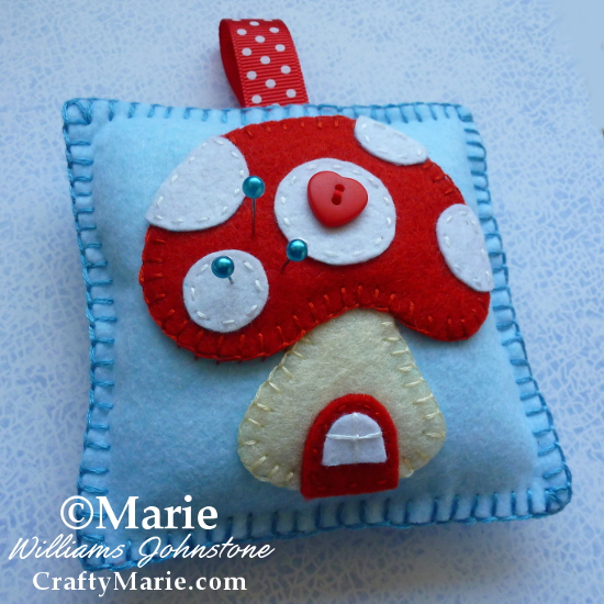 Toadstool mushroom house pin cushion pincushion beginner project craft blue and red craftymarie