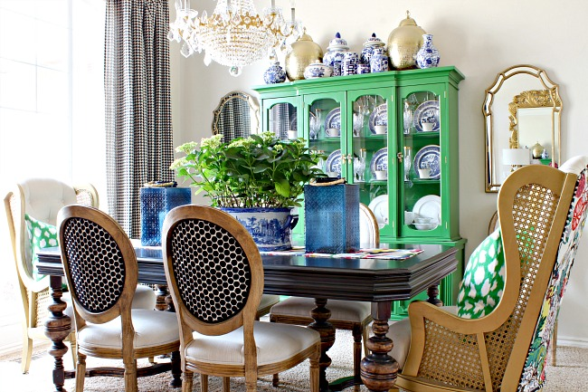 antique dining table with turned legs, vintage cane wingback chair, kate spade leokat fabric, blue glass lanterns, blue willow, green china cabinet, houndstooth drapes