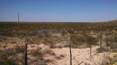 A photo of the three graves located on the Slash Ranch in Texas.