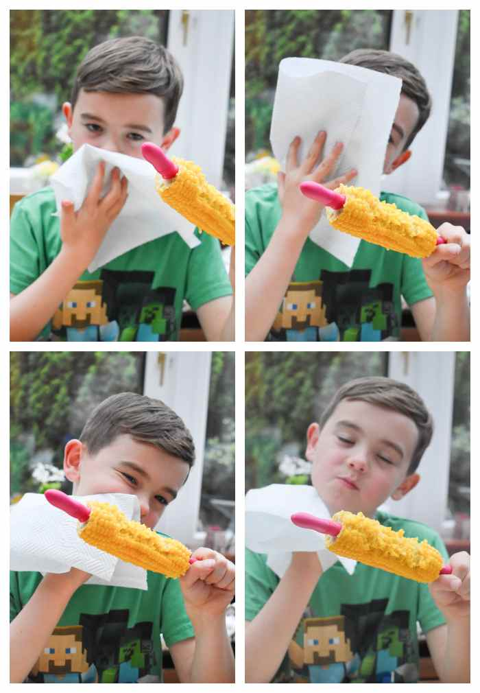 Moping up butter from corn on the cob