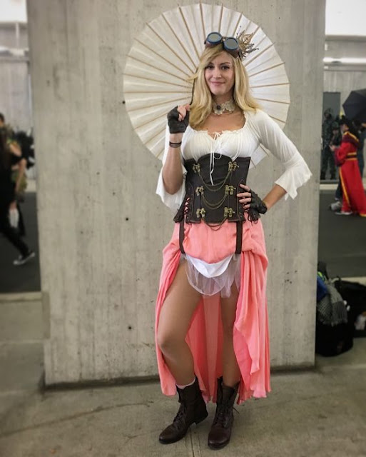 Woman dresssed as Steampunk Princess Peach from Super Mario Bros video games. Gamer costume ideas for women.