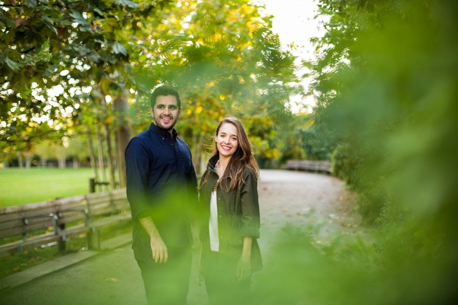 Casual lifestyle engagement photos in tree lined path Brooklyn Bridge Park - Cassie Castellaw