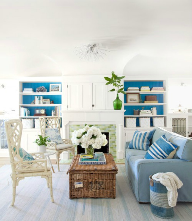 Beautiful blue coastal living room with pale blue slipcover sofa
