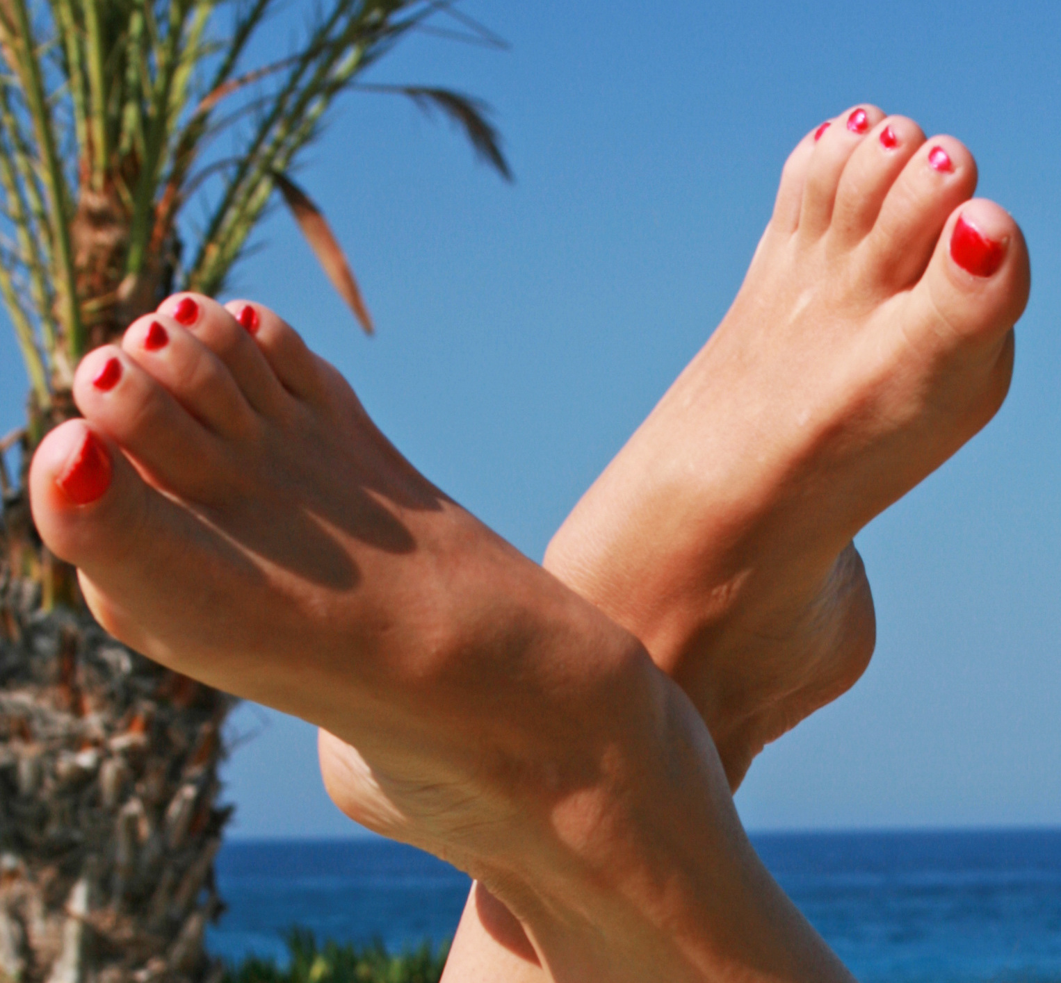 Image showing a woman's feet with sea and blue sky