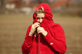 woman-hiding-face-in-jacket.jpeg
