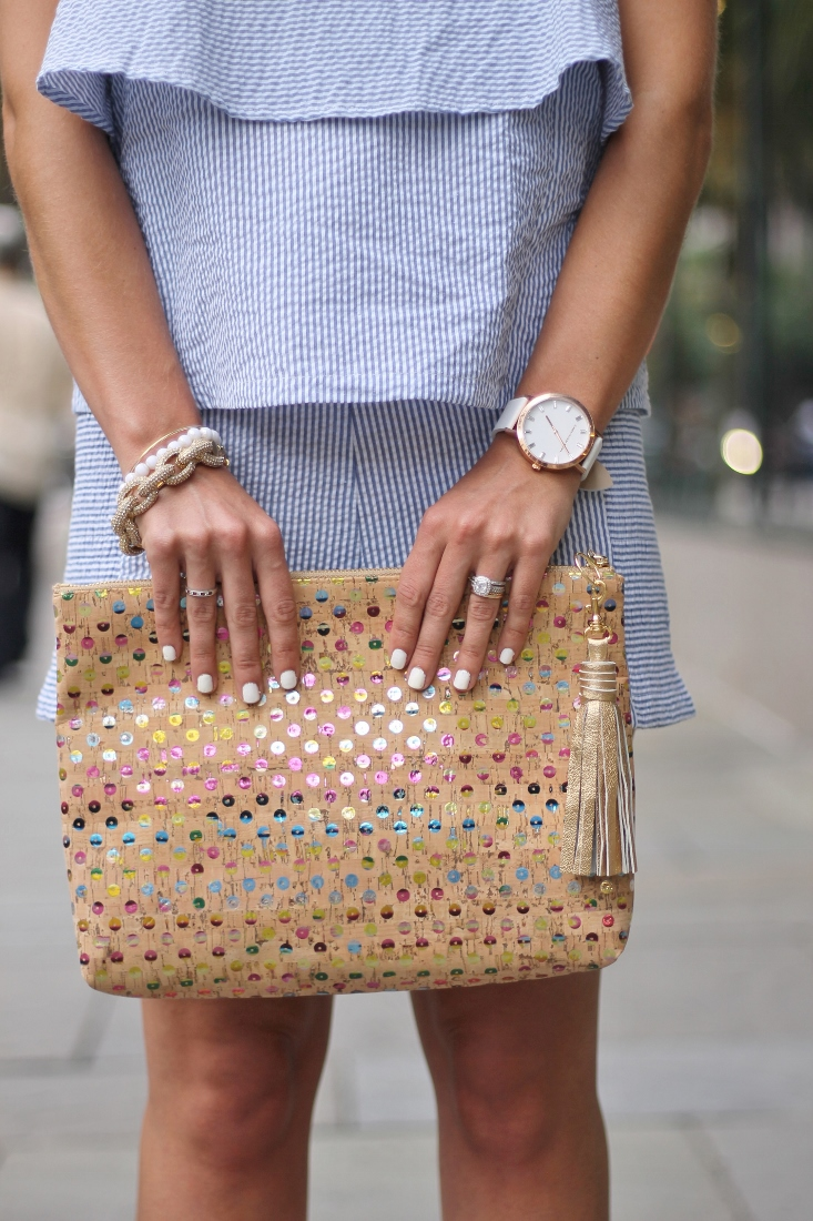 Sequin and cork clutch with gold tassel