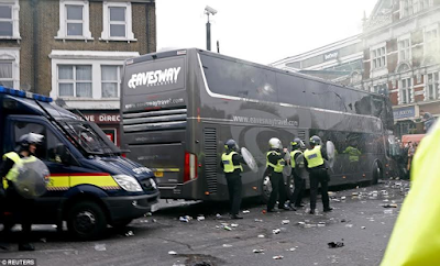 police protects Manchester united players as their bus is attacked