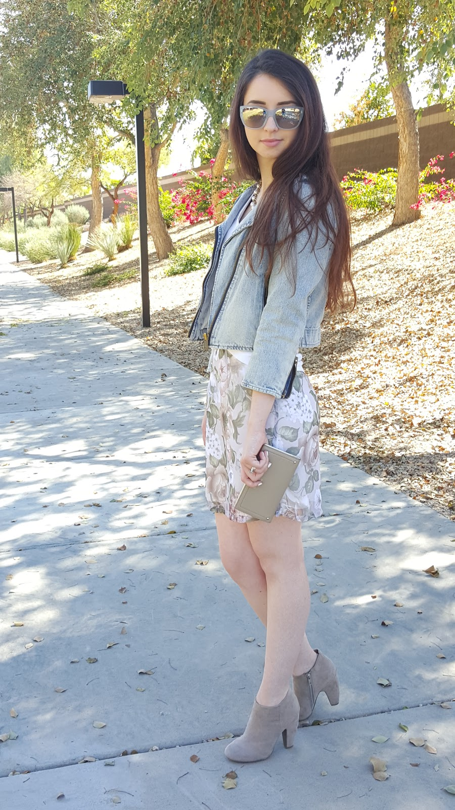 pastel mini skirt with a denim jacket and booties for a Spring transition outfit