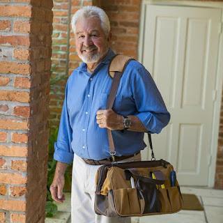 Man carrying the Bob Vila Signature Series Workman's Tool Bag