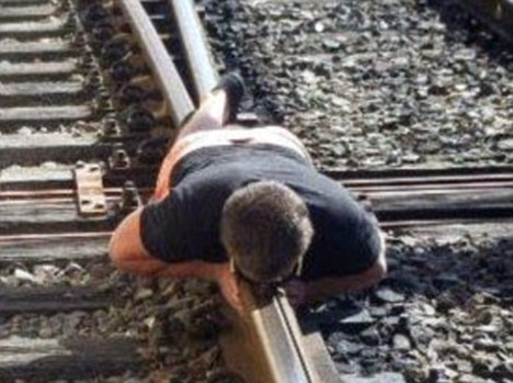 Teenager charged with trespassing on railway - after planking photo ends up on Facebook