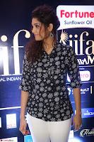 Ritika Singh in Black Printed Shirt and White Leggings at IIFA Utsavam Awards press meet 27th March 2017 20.JPG