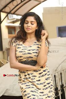 Telugu Actress Karunya Chowdary Stills in Short Dress at ATM Not Working Press Meet  0102.jpg