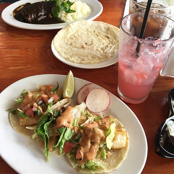 Mole chicken and halibut tacos from La Carta de Oaxaca with watermelon agua fresca