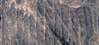 abstract landscapes of deserts of Africa from the air, Mirage in the desert with fossilized bread bars arranged as cracks in the rock, in the mountains,