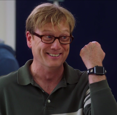 Dave, a white man with glasses and blonde hair, shows off his Apple watch, which has square metal pyramids on the band