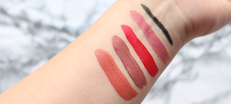 Swatches Kat Von D Everlasting Liquid Lipstick in Lolita II, Lolita I and Outlaw, Studded Kiss Lipstick in Magick, and Tattoo Ink Liner in Trooper.
