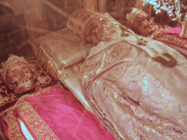 in MIlan, skeletal relics of twin brothers Saiint Gervasius & Saint Protasius flank that of St Ambrose in the crypt of the Basilica di Sant'Ambrogio