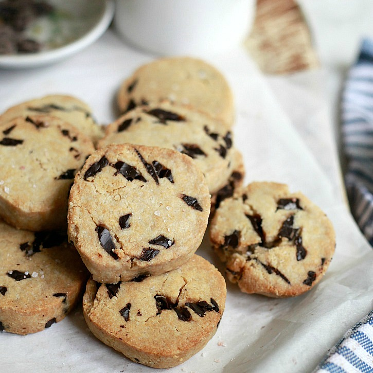 Delicious vegan, gluten-free, and paleo slice and bake chocolate chip cookies.