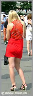 Girl on the street wearing red summer dress