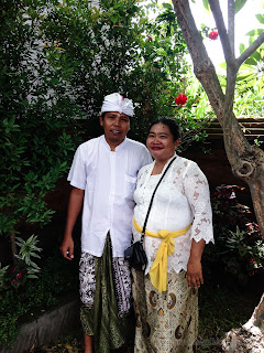Husband And Wife With Balinese Custome In The Garden Of The Temple During Galungan Ceremony At Dalem Temple Ringdikit