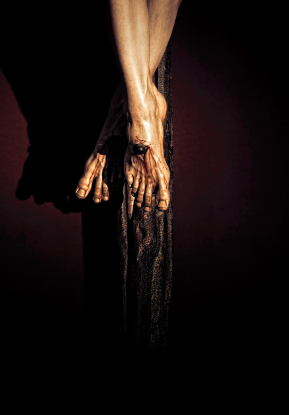 Detail of feet: The figure of Christ Crucified in Cristo de la Clemencia as sculpted by Juan Martinez Montanes in 1603 and is done in wood. Copyright ©2012 iStockphoto LP. THEPALMER