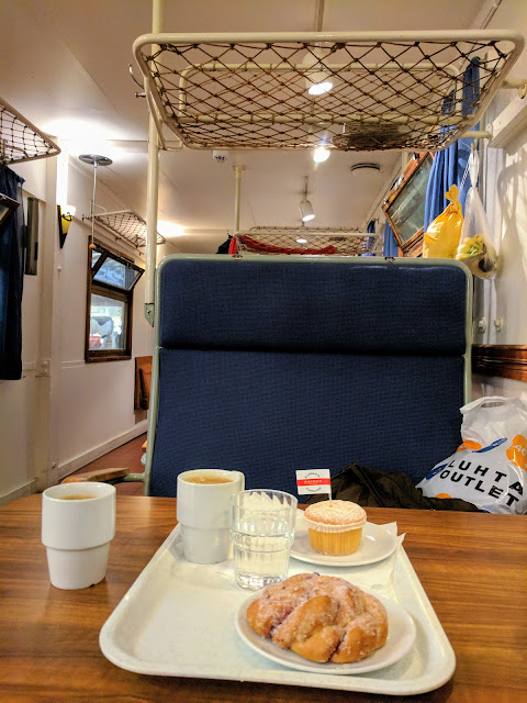 Cake and a bun served in an old train car inside Turku Market Hall on a Finland road trip