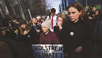 Thunberg (center) takes part in a march in Brussels for the environment and the climate organised by students. (Credit: gulf-times.com) Click to Enlarge.