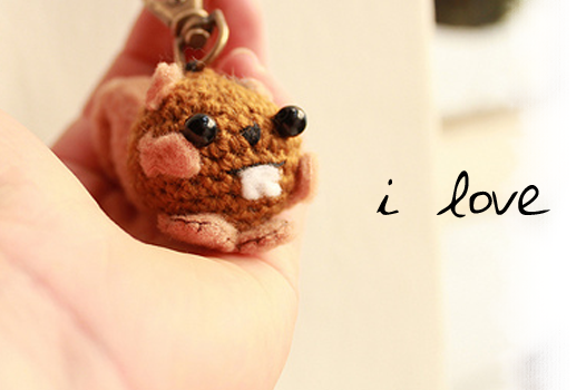 This amigurumi squirrel wants all your keys! An easy amigurumi keychain crochet pattern  by The Sun and the Turtle.