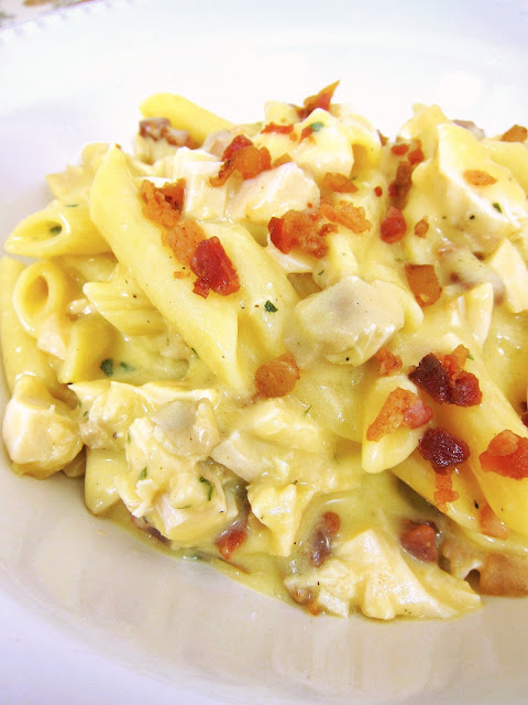 Cracked Out Chicken Pasta - chicken, and bacon tossed in a quick homemade cheesy ranch sauce! Ready in under 15 minutes. Such an easy weeknight meal!! Everyone in the family loves this! Serve with a salad and some crusty garlic bread - so delicious! We make this all the time!