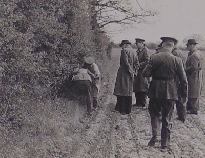 Photo taken by Harold Dearden showing group of MI5 officers retrieving Richter's parachute from a hedge near White Horse Lane.