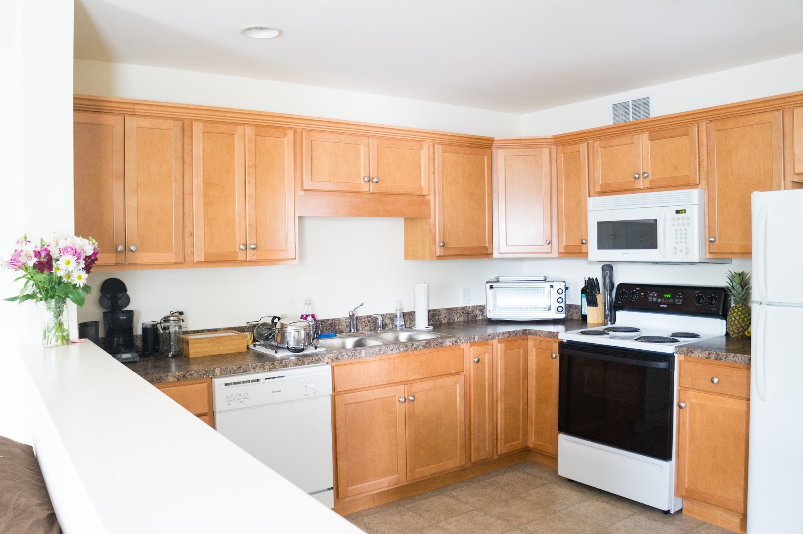 Kitchen with natural colored cabinets