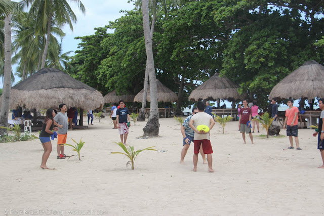 Playing Frisbee in beach - Cowrie Island