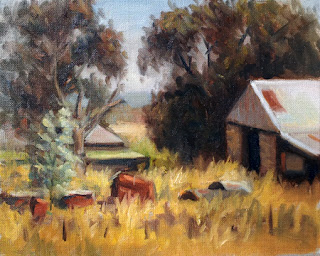 Oil painting of a bluestone barn with corrugated iron roof beside several eucalytpts and surrounded by dry grass.