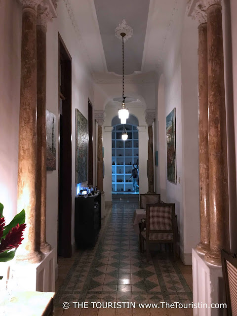 Interior and tiled hallway at restaurant Le Chansonnier in Havana in Cuba