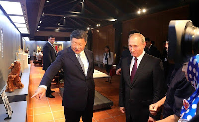 Vladimir Putin with President of China Xi Jinping.