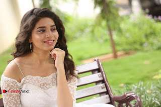 Actress Tejaswini Pictures in White Dress at Lachhi Teaser Launch  0297.JPG