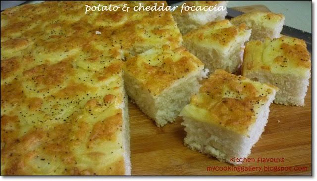Once the focaccia has completed baking, loosen the sides of focaccia ...