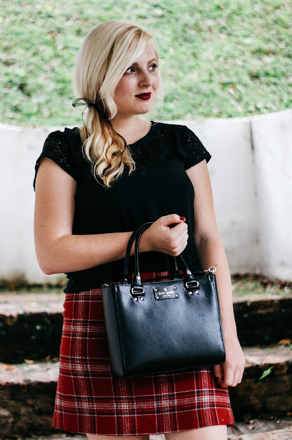 Fashion Blogger CityFashionGirl (Brianna Degaston) wearing a red tartan skirt and a black Kate Spade Purse in Fort Canning Park in Singapore