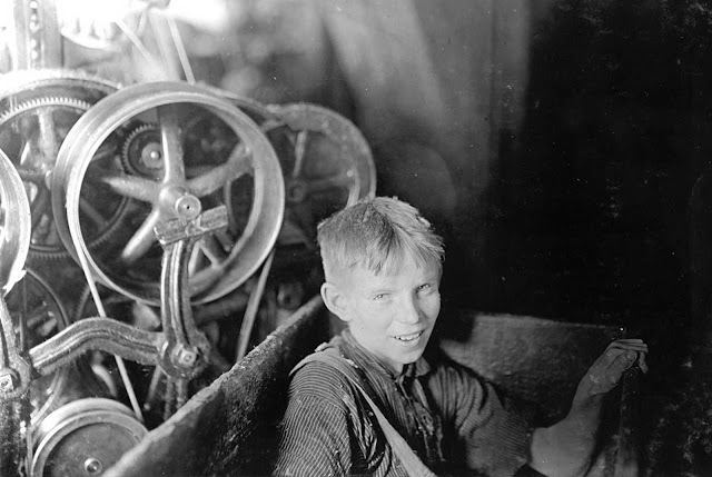 Willie, one of the young spinners in the Quidwick Co. Mill in Anthony, Rhode Island. He was taking his noon rest in a doffer-box on this day in April of 1909.