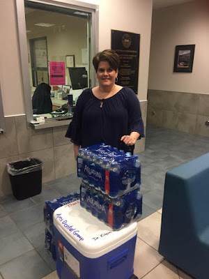 Cindy poses with cooler and water at the Apex Police Station